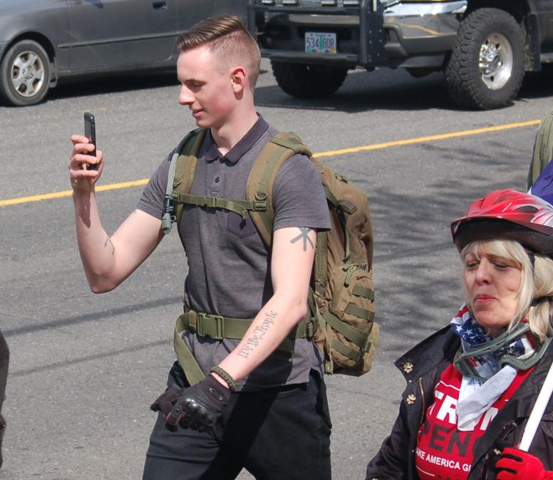 Jake Von Ott marching on NE 82nd Ave