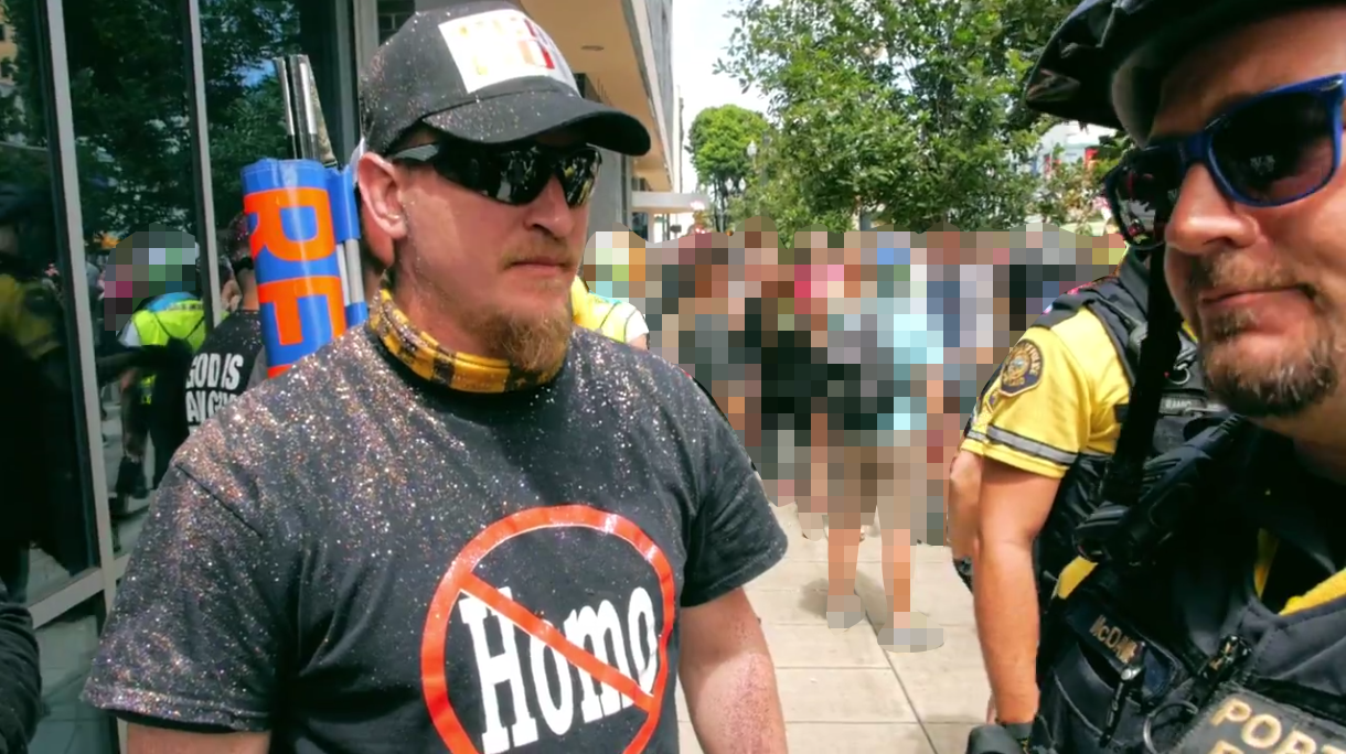 Allen Pucket begs the police to escort him to safety after harassing PDX Pride
