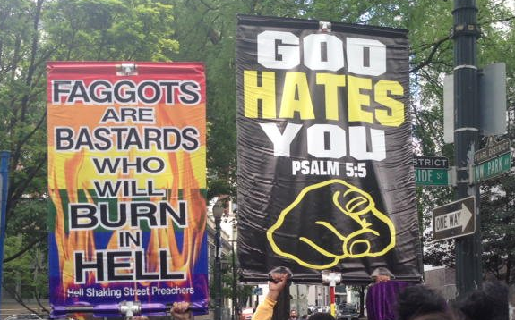 Homophobic signs carried by Allen Pucket and his followers with Joey Gibson at the Portland Pride parade