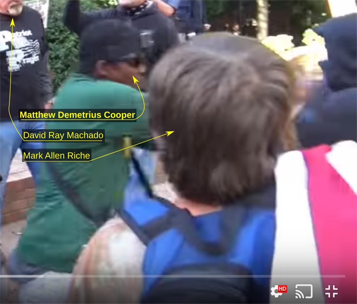 Deme Cooper shoves an anti-fascist activist down concrete stairs at an October 8 Patriot Prayer rally in Portland OR