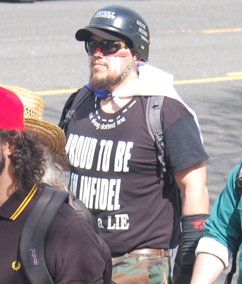 Michael Pena displays an Islamophobic slogan on his shirt
