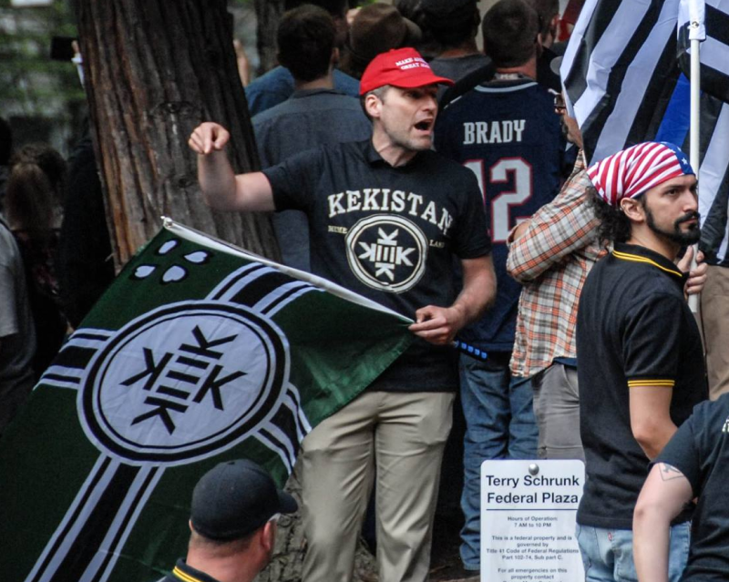 a participant at Joey Gibson's June 4th rally flies a pallet swapped nazi flag