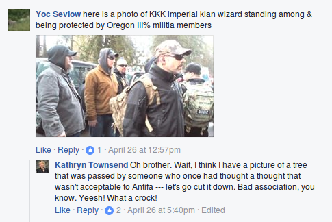 Kathryn Townsend brushes off a photograph of right wing militia members protecting KKK Imperial Wizard Steven Shane Howard at a Trump rally in Lake Oswego