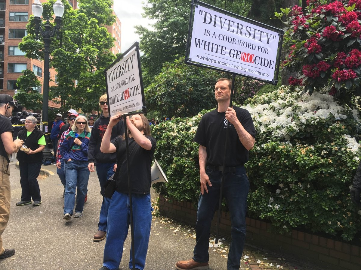 Two participants in Joey Gibson's 6/4 rally display racist