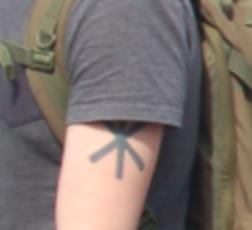 upper left arm tattoo