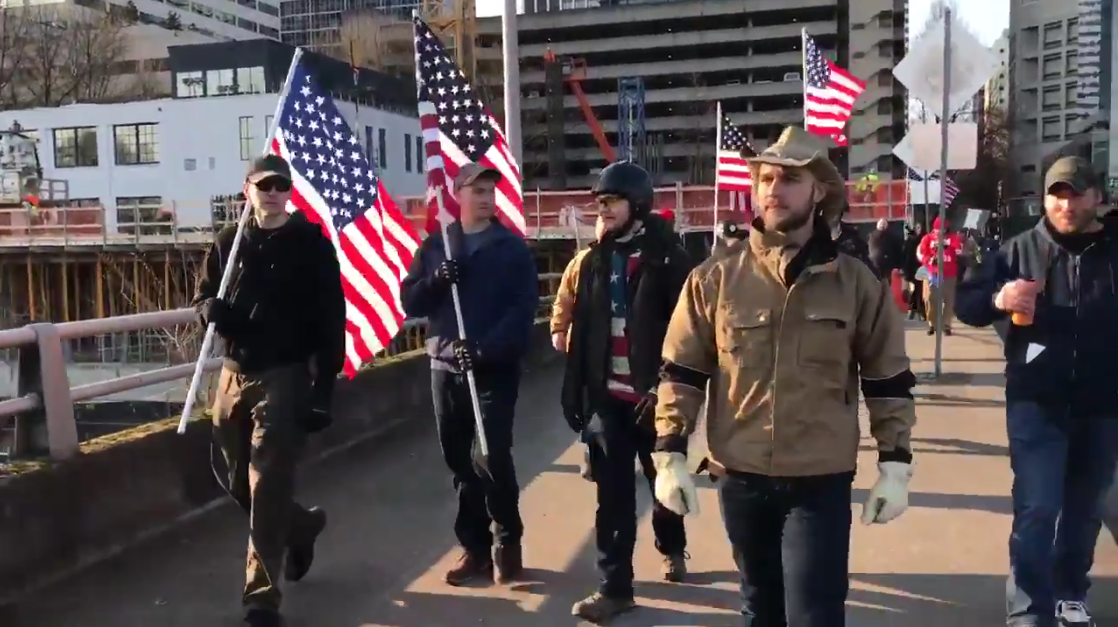 Aaron Williamson attends an anti-immigrant hate rally