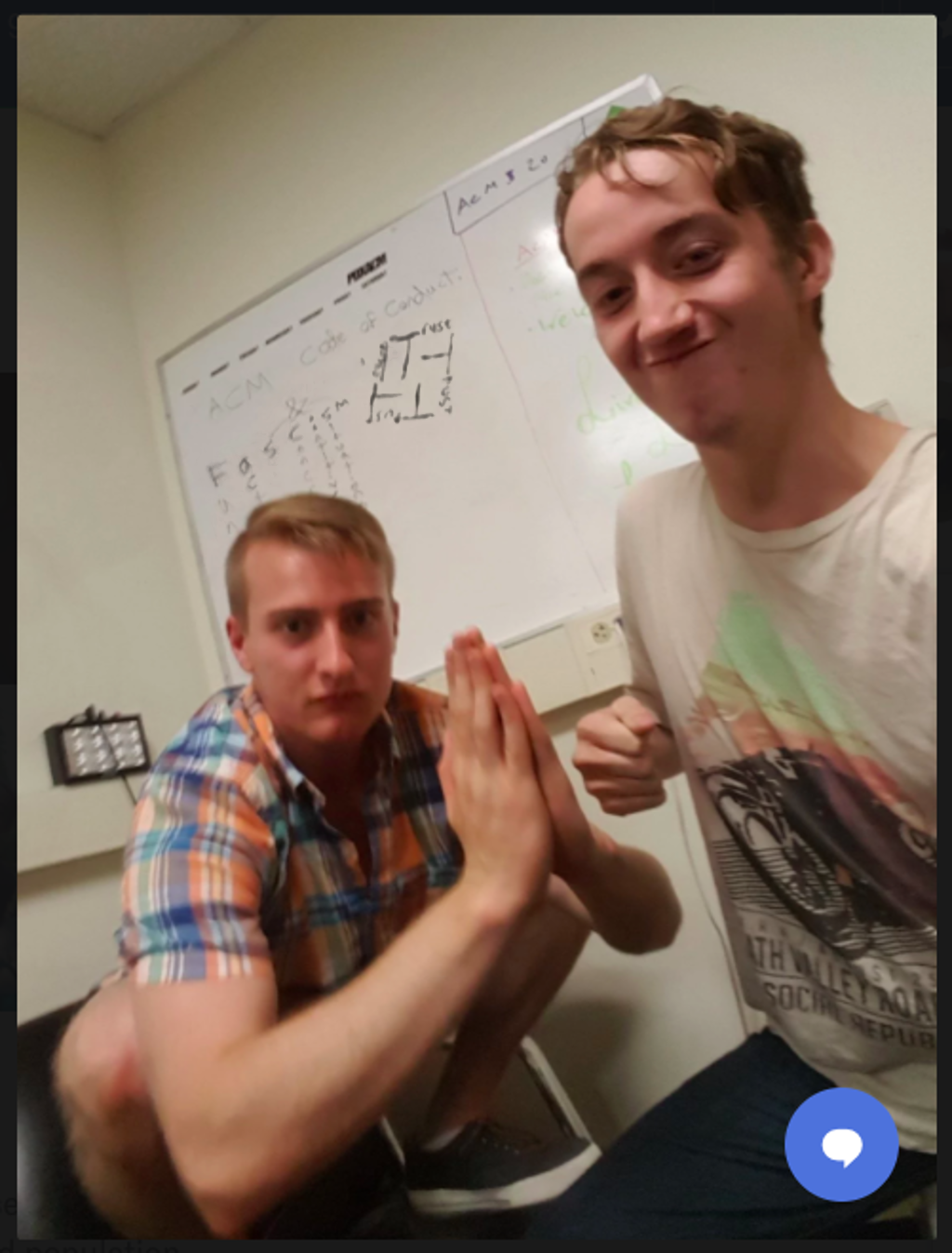 Stephen Johnston and Liam Wynn pose with a swastika